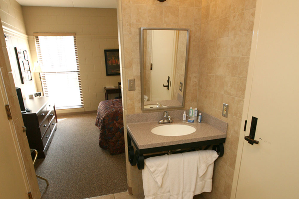A personal sink is in each room. Towels and wash cloths are provided. Complementary toothbrush, toothpaste, soap, shampoo, conditioner, razor, and tissues are available. A hairdryer is located at the front desk by request. Rooms are maintained with a maid service each morning.