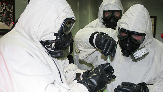 Emergency responders attending the Technical Emergency Response Training (TERT) course sample for the possible detection of the biological material Ricin. These students worked with biological materials Ricin and Anthrax, and also nerve agents GB and VX, during their course.