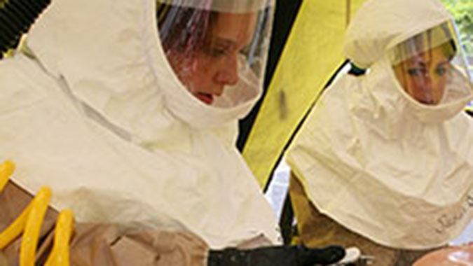 A nurse from Tennessee decontaminates a simulated patient during a mass casualty exercise at the Center for Domestic Preparedness (CDP). Ten hospitals representing the northeast region of Tennessee sent 37 employees to the CDP's Hospital Emergency Response Training for Mass Casualty Incidents (HERT)
