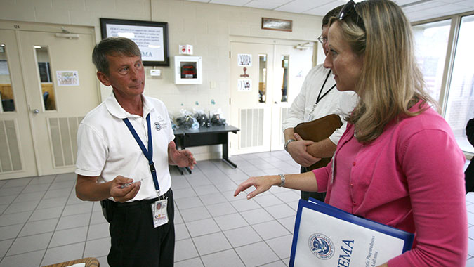 Woody Davis (LEFT), COBRA TF Operations officer, briefs a visitor on COBRA operations.