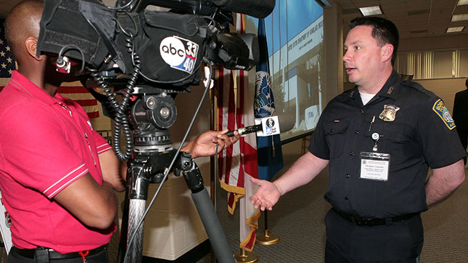 Michael Connolly, Boston Police Officer, answers questions from local media following his comments at the CDP's 15th Anniversary celebration in June. Connolly credits CDP training for his unit's response following the Boston Marathon bombing.
