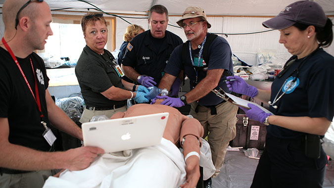DMAT members treat the symptoms shown by a patient simulator while training at FEMA's Center for Domestic Preparedness (CDP). A DMAT is a group of professional medical personnel, supported by logistics and administrative teams. The teams are designed to provide medical care during a disaster or othe
