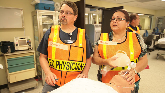 Tribal healthcare professionals respond to a mass casualty event in the emergency department (ED) of the Noble Training Facility (NTF) at the CDP. The NTF is the only hospital in the nation solely dedicated to preparing the healthcare, public health, and environmental health communities for mass cas