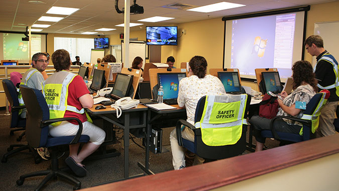 Healthcare professionals attending training at FEMA's Center for Domestic Preparedness (CDP) staff the hospital's command center during a simulated exercise. The newly renovated area serves as an Emergency Operations Center (EOC) or command center during healthcare training. The EOC is located at th