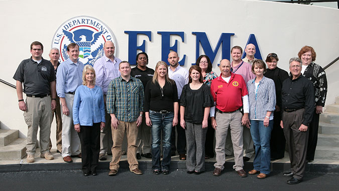 Members of the Emergency Management Coalition of Eastern Alabama pose for a photo at FEMA's Center for Domestic Preparedness (CDP). The coalition recently toured the CDP during its quarterly meeting. Front Row L to R - Denise Cooey (Deputy Director EMA Etowah Count.), Dr. Eric Best (JSU), Ashley Sis