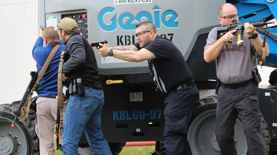 A group of law enforcement officers take up positions against an active shooter during the Integrated Capstone Event conducted as part of the CDP's Complex Coordinated Attack Theme Week. The week brought together law enforcement, hazardous materials, healthcare and emergency management specialists a