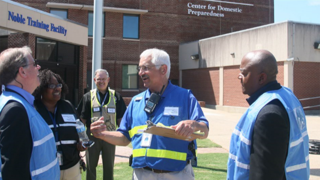 U.S. Senator Doug Jones (D-AL), left, enjoys a lighter moment with members of the CDP team, including (l-r) Mellione Richards, Charles Reneau, Pete Zekoff and CDP Superintendent Tony Russell.  Jones toured the CDP June 29 and got the chance to see healthcare students taking part in a mass casualty a
