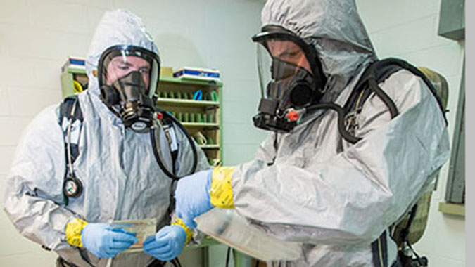 HAZMAT Ops students in personal protective equipment apply newly acquired assessment skills during a hands-on exercise at the CDP.