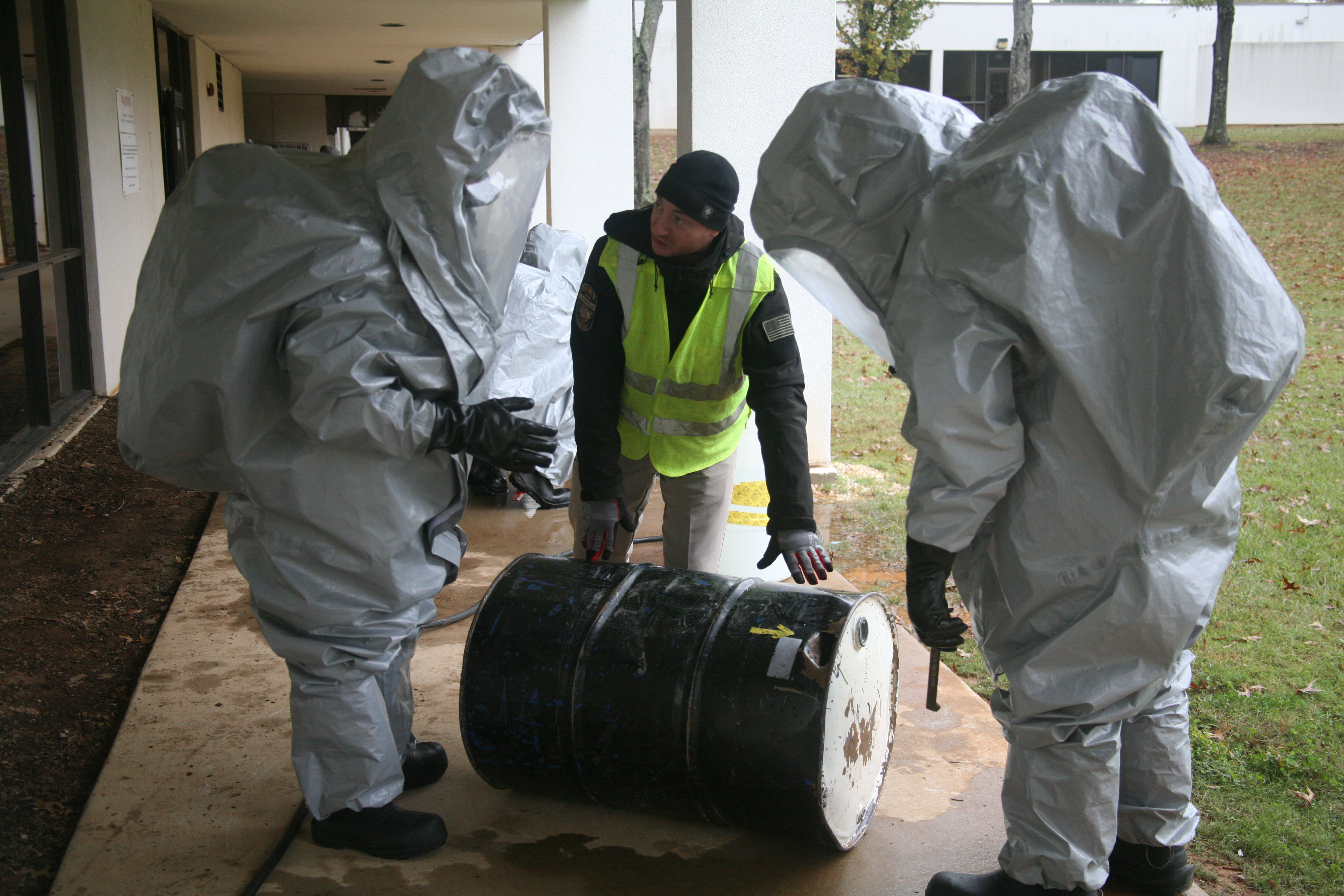 CDP Instructor Jeremy Urekew, center, points out damages on a training barrel to students attending the Hazardous Materials Technician course, noting that punctures in barrels can lead to emissions of both liquid and gaseous hazardous material.