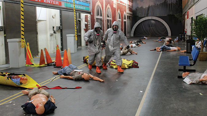 Students in the Emergency Medical Operations for CBRNE Incidents (EMO) course pull survivors from the contaminated incident scene during the Integrated Capstone Event, Nov. 20. The scene was staged in the CDP's Advanced Responder Training Complex's Indoor Street Scene training venue, which includes