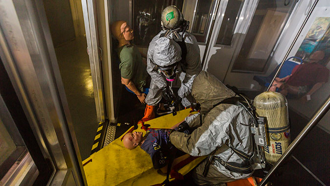 "Students prepare a ""patient"" for transport from the subway training venue in the CDP's Advance Responder Training Complex."
