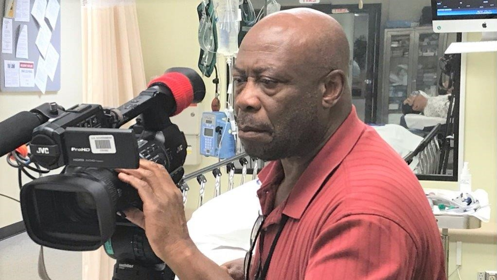 Videographer Rudy Marshall films activity in the Noble (Hospital) Training Facility's Emergency Room.