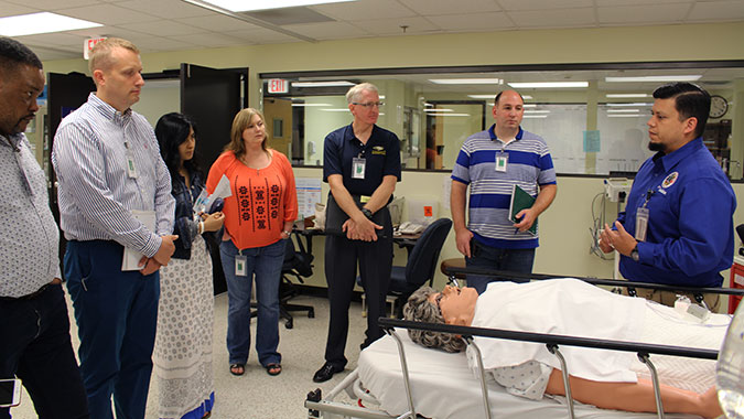 Ian Jones, Medical Simulation Technician Team Lead, at the CDP's Noble Training Facility, demonstrates the abilities of a human patient simulators for the students.