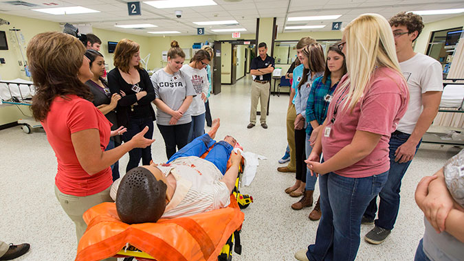 Students learn how a patient simulator is used in healthcare training during a tour of the Center for Domestic Preparedness (CDP). Fifty local high school students, enrolled in Community Emergency Response Team Training, toured the CDP on FEMA's first National Day of Action.