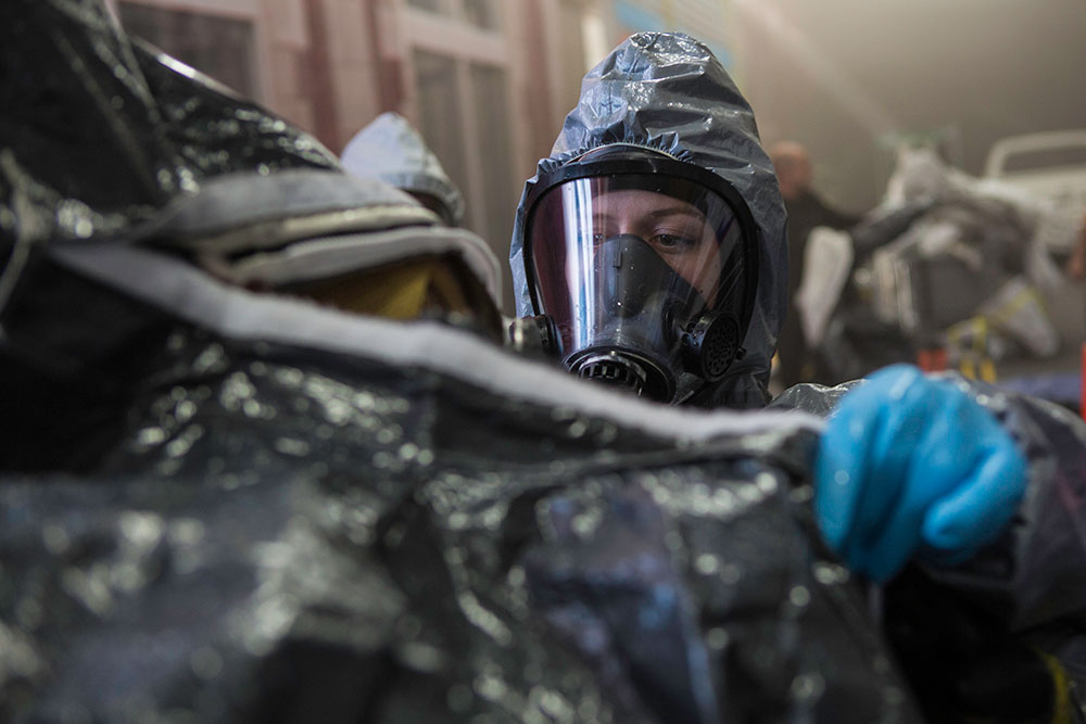 Emergency response personnel remove a Level-A suit as part of technical decontamination inside the CDP Advanced Responder Training Complex. CDP training focuses on incident management, mass casualty response, and emergency response to a catastrophic natural disaster or terrorist act. CDP training for state, local, and tribal responders is fully funded by FEMA, a component of the U.S. Department of Homeland Security. Round-trip air and ground transportation, lodging, and meals are provided at no cost to responders or their agency. To learn more about the Center for Domestic Preparedness, visit http://cdp.dhs.gov or call 866-213-9553. Photo by Benjamin Crossley CDP/FEMA