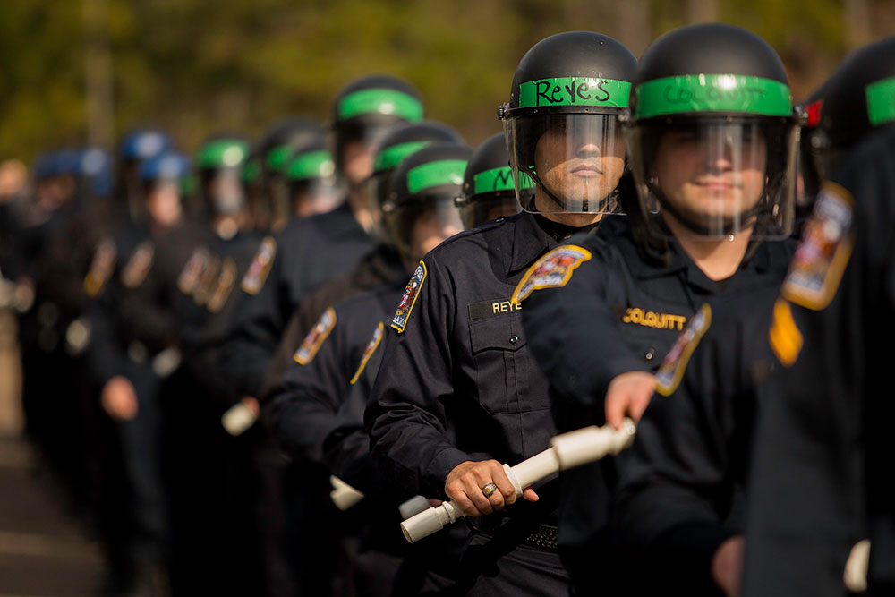 Members of law enforcement practice crowd control tactics at the CDP. The CDP provides law enforcement officers with Chemical, Biological, Radiological, Nuclear, and Explosive specific response skills. The courses present topics such as terrorist tactics, indicators of terrorism, and protective measures. Other Field Force Training is offered for National Special Security Events (NSSE). NSSE training focuses on crowd control, protester extrication tactics, and incident management used by law enforcement. CDP training focuses on incident management, mass casualty response, and emergency response to a catastrophic natural disaster or terrorist act. CDP training for state, local, and tribal responders is fully funded by FEMA, a component of the U.S. Department of Homeland Security. Round-trip air and ground transportation, lodging, and meals are provided at no cost to responders or their agency. To learn more about the Center for Domestic Preparedness, visit http://cdp.dhs.gov or call 866-213-9553. Photo by Benjamin Crossley CDP/FEMA